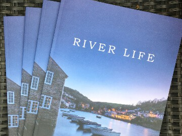 Outside front cover of River Life print brochure